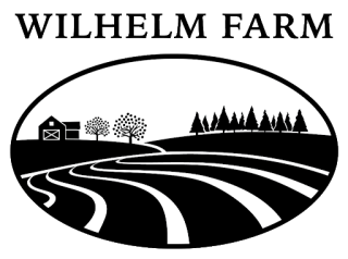 Black and white image of farm field, house, and forest.