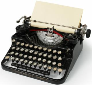 Antique typewriter with blank sheet of paper.